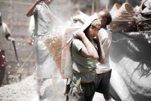 a man carries a bag on his head in Kathmandu