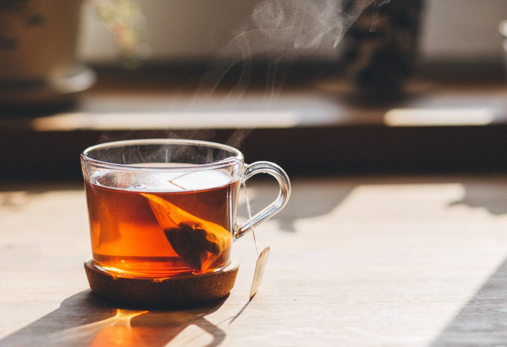 Cup of steaming tea in the sunlight