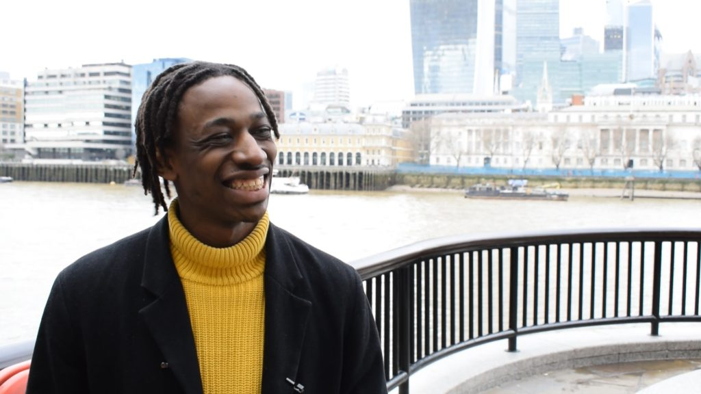 Photograph of Shingi Mararike, The Sunday Times' first apprentice, against a backdrop of the Thames
